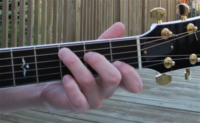 Place your fingers directly behind the correct frets to avoid string buzz.